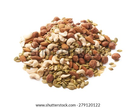 Pile of multiple nuts and seeds isolated over the white background