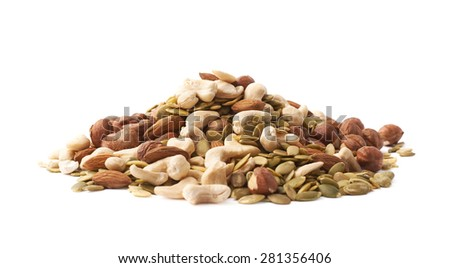 Pile of multiple nuts and seeds isolated over the white background - stock photo