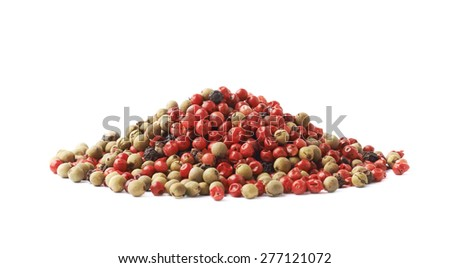 Pile of multiple red, white and black pepper seeds mix isolated over the white background - stock photo