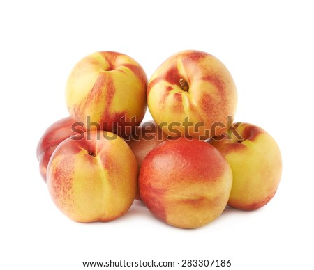 Pile of multiple ripe nectarines, composition isolated over the white background - stock photo