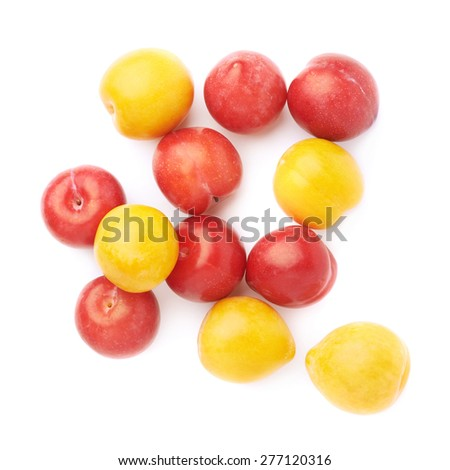 Pile of multiple yellow and red plums, composition isolated over the white background