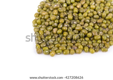 Pile of mung beans isolated on white.