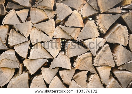 Pile of neatly stacked dry firewood - stock photo