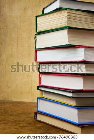 pile of new and old books on wood texture - stock photo