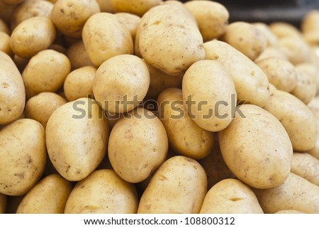 pile of new potatoes for sale to the market - stock photo