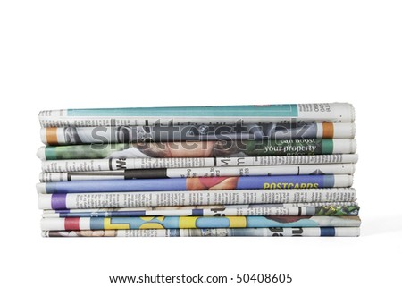 Pile of newspapers isolated on white. Clipping path included. - stock photo