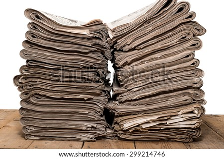Pile of newspapers. isolated over white - stock photo