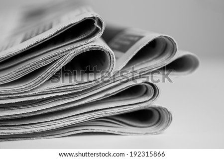 Pile of newspapers, processed in black and white - stock photo