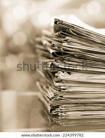 Pile of newspapers with space. - stock photo