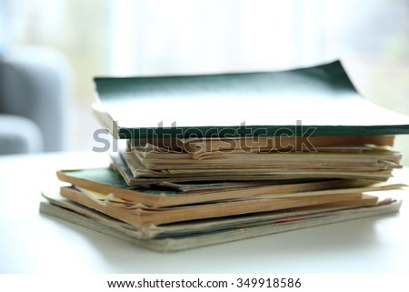 Pile of old books on white table - stock photo