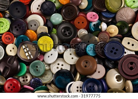 Pile of old buttons of different colour - stock photo