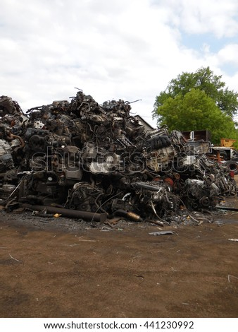 Pile of old car engines in a junk yard - stock photo