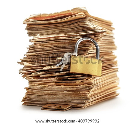 Pile of old cards with keylock in closeup - stock photo