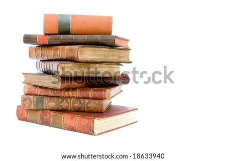 Pile of old leather bound books isolated on a white background
