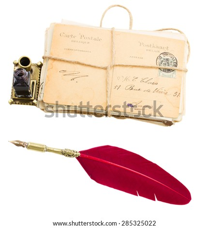 pile of old mail with inkwell  and red feather pen isolated on white  - stock photo