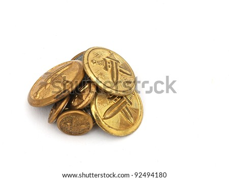 Pile of old military metal buttons - stock photo