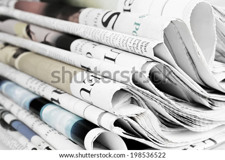 Pile of old newspapers - stock photo
