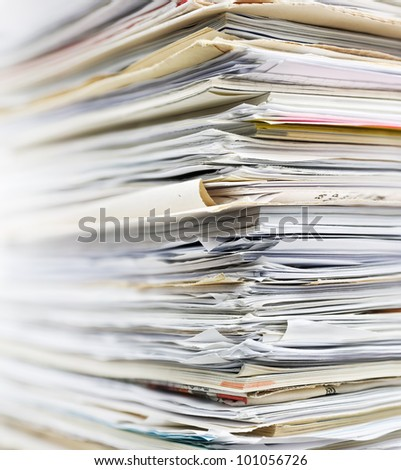 Pile of old paper for recycling. Small depth of field - stock photo