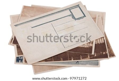 Pile of old postcards with copy space isolated on white background
