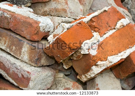 Pile of Old, Used Bricks with Mortar - stock photo