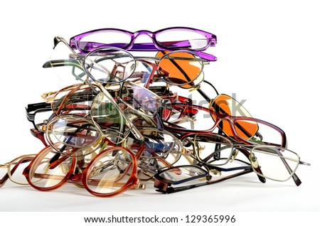 Pile of old used spectacles - stock photo