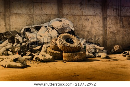 Pile of old used tires and rubber garbage for recycling  - stock photo