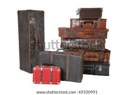 Pile of old vintage suitcases - luggage isolated on white - stock photo