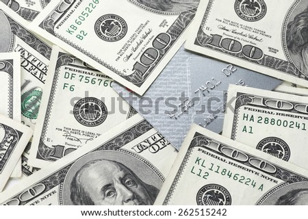 Pile of one hundred dollar bills and plastic card close-up. - stock photo