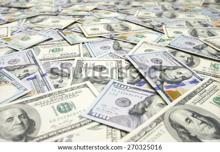 Pile of one hundred dollar bills new and old design. Wide angle view. - stock photo