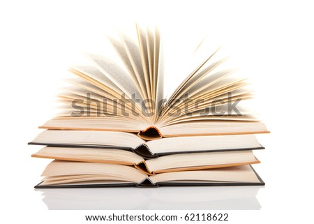 pile of open books isolated on white background
