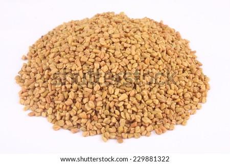 Pile of organic fenugreek.shallow depth of field photograph.  - stock photo