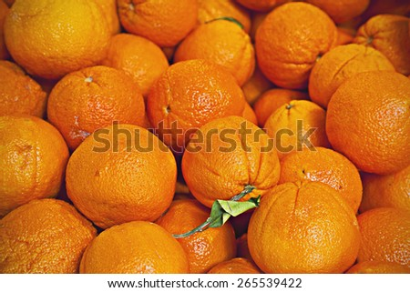pile of organic oranges at market stall - stock photo
