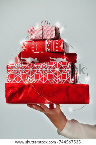 Pile Of Packed Christmas Gifts On White Background