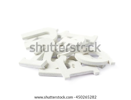 Pile of painted wooden letters isolated over the white background - stock photo