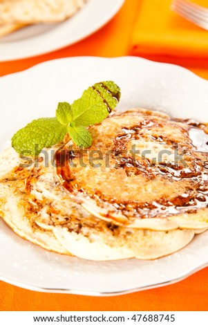 pile of pancakes drizzled in caramel and mint