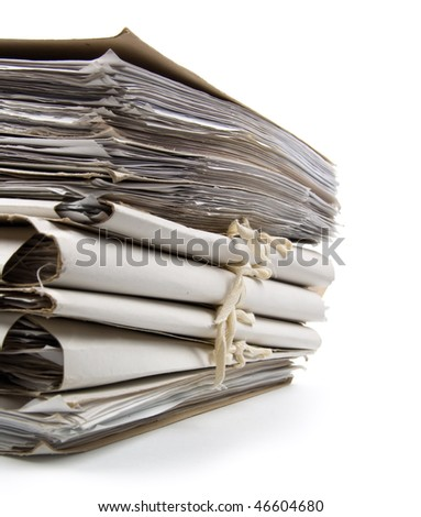 Pile of paperwork on a white background. Close-up.