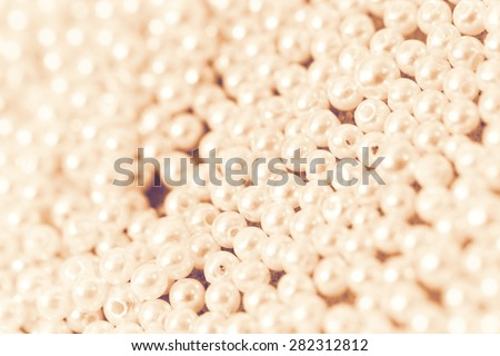 Pile of pearl on the yellow background - stock photo