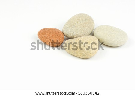 Pile of pebbles isolated over white - stock photo