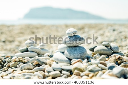 Pile of pebbles on the beach at Alanya Mediterranean sea coast, Turkey. Concept of balance, relaxation and harmony. Mount at background - stock photo