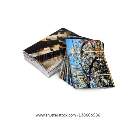 Pile of photos printed on photo paper - stock photo