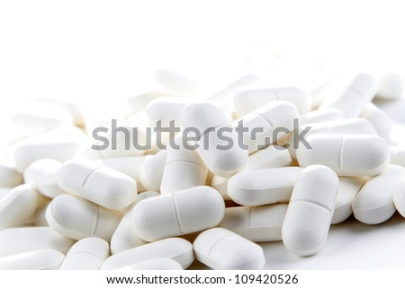 Pile of pills, copy space top - stock photo