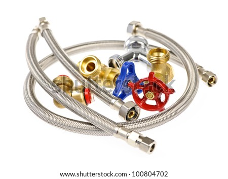 Pile of plumbing valves hoses and assorted parts isolated on white background - stock photo
