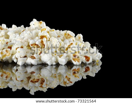 Pile of popcorn photographed on black (Selective Focus, Focus on front) - stock photo