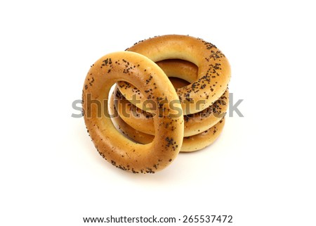 Pile of poppy bagels on a white background - stock photo