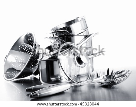Pile of pots and pans against a white background - stock photo