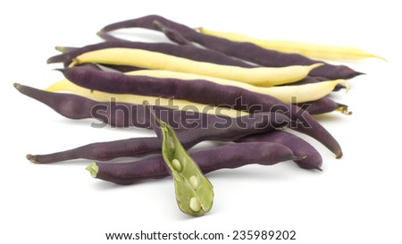 Pile of purple and yellow string beans isolated on white - stock photo