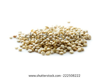 pile of quinoa seeds isolated on  a white background - stock photo