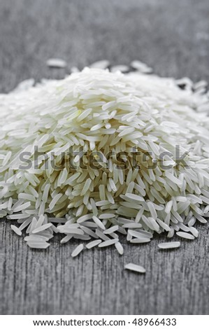 Pile of raw long grain white rice grains - stock photo