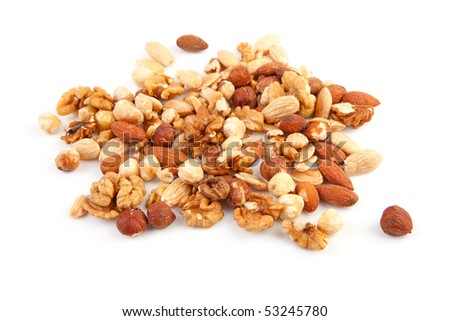 pile of raw mixed nuts isolated on white background - stock photo