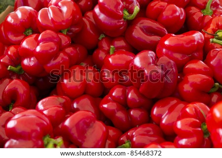 Pile of red bell peppers. - stock photo